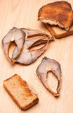 Toast from bread with pieces smoked fish Royalty Free Stock Photo
