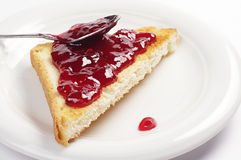 Toast bread with raspberry jam Stock Photos