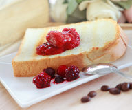 Toast bread on strawberry jam Royalty Free Stock Images