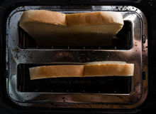 Toast Bread in a toaster Royalty Free Stock Photography