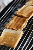 Toast bread on toaster. In hotel Stock Photos