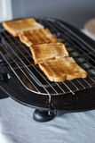 Toast bread on toaster. In hotel Royalty Free Stock Images