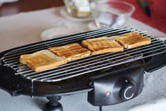 Toast bread on toaster. In hotel Royalty Free Stock Photo
