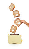 Toast bread and toaster on white Royalty Free Stock Photo