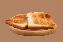 Toast bread on wooden plateau Stock Images