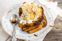Toast for breakfast with cream cheese and sweet pear, nuts Royalty Free Stock Image