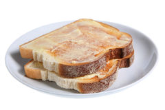 Toast & Butter. Two slices of hot buttered toast on a white plate Stock Photos