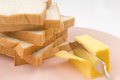 Toast and butter. Toast, butter and butter knife. cutting butter Royalty Free Stock Image