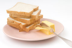 Toast and butter. Toast, butter and butter knife. cutting butter Royalty Free Stock Images
