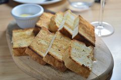 Toast and butter. Baked douch toast with butter stock image