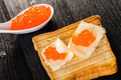 Toast with butter and caviar Royalty Free Stock Image
