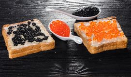 Toast with butter and caviar Royalty Free Stock Photos