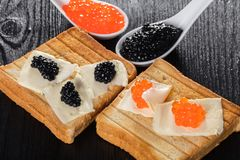 Toast with butter and caviar Royalty Free Stock Photography