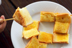 Toast with butter and sprinkling with sugar. Royalty Free Stock Photo