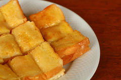 Toast with butter and sprinkling with sugar Royalty Free Stock Photo