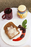 Toast with Butter, Strawberry Jam and Coffee. Toast with Butter, Strawberry Jam, Mint Leaves and a Coffee Set Royalty Free Stock Image