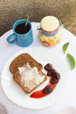 Toast with Butter, Strawberry Jam and Coffee. Toast with Butter, Strawberry Jam, Mint Leaves and a Coffee Set Royalty Free Stock Photo
