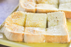 Toast with butter topping Stock Photography