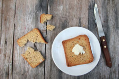 Toast with butter Stock Images