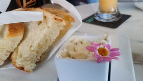 Toast buttery spread flower fancy on diner table closeup stock photo