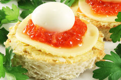 Toast with caviar and quail eggs Stock Photography