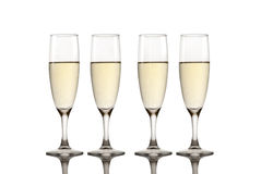 Toast champagne. Four glasses new year with reflex Royalty Free Stock Photo