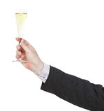 Toast with champagne glass in businessman hand Stock Image