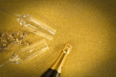 Toast champagne. Glass on golden background Stock Photography