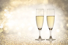 Toast champagne. Glass on golden background Stock Image