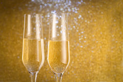 Toast champagne. Golden background new year Stock Images