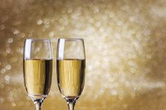 Toast champagne, new year golden background Stock Photo