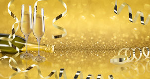 Toast champagne. Party toast champagne, golden background, golden bow Royalty Free Stock Image