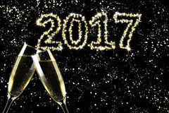 Toast champagne, sparkle sky happy new year. Flute Stock Photos