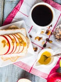 Toast with cheese, apple and dried fruit, a cup of coffee Stock Photo