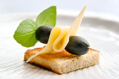 Toast with cheese and olive Stock Photos