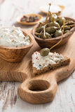 Toast with cheese pate and capers Stock Image
