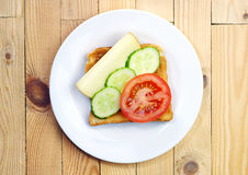 Toast with cheese, tomato and cucumber Royalty Free Stock Images