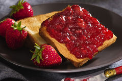 Toast with cherry jam Stock Photos