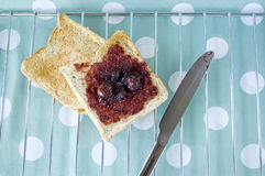 Toast with cherry jam stock photography