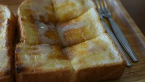Toast with condensed milk and sugar stock footage