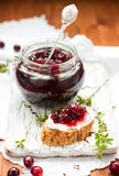 Toast with cranberry jam Royalty Free Stock Photography