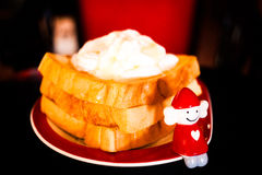 Toast and cream Stock Images