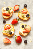 Toast with cream cheese, strawberries, blueberries, almond flake Royalty Free Stock Photo