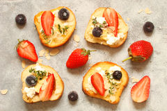 Toast with cream cheese, strawberries, blueberries, almond flake Stock Image