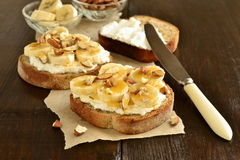 Toast with cream cheese, topped with banana, almonds, honey Royalty Free Stock Photos