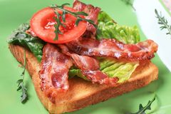 Toast with crispy bacon strips Stock Image