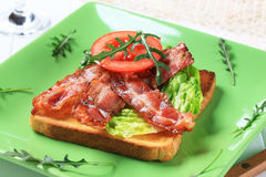 Toast with crispy bacon strips Royalty Free Stock Images