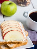 Toast with curd cheese, apple, honey and dried fruits, coffee Stock Image