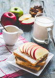 Toast with curd cheese and sweet red apple, a cup of milk Stock Images