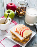 Toast with curd cheese and sweet red apple, a cup of milk Royalty Free Stock Images